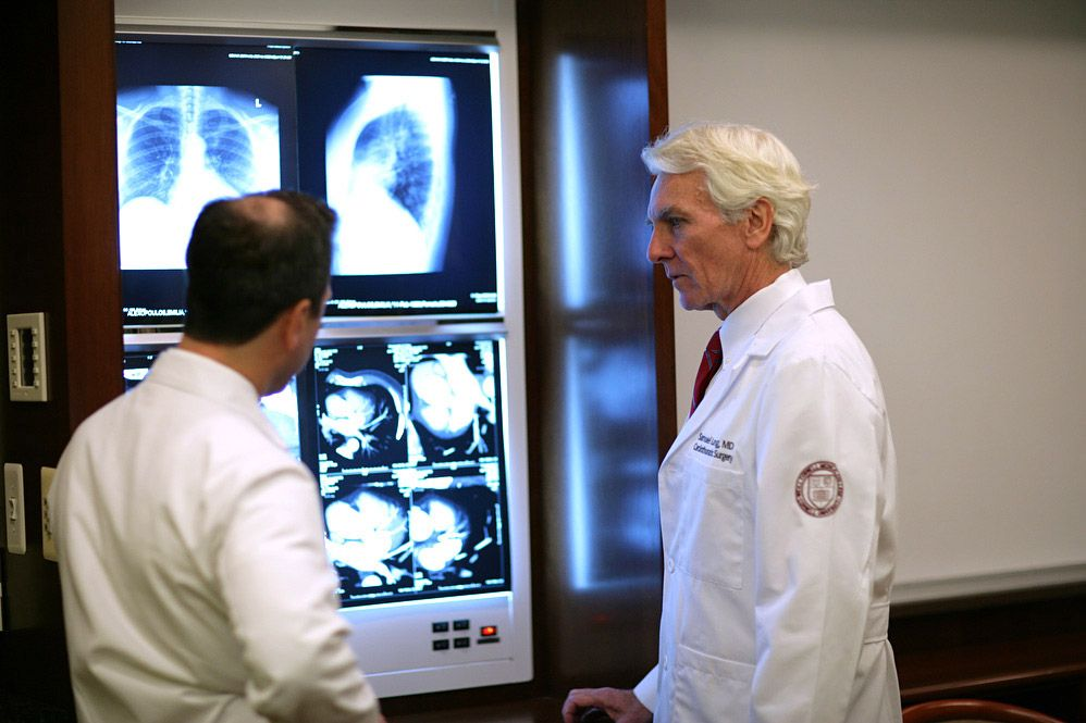 Surgeons look at x-rays to identify cardiac tumors.